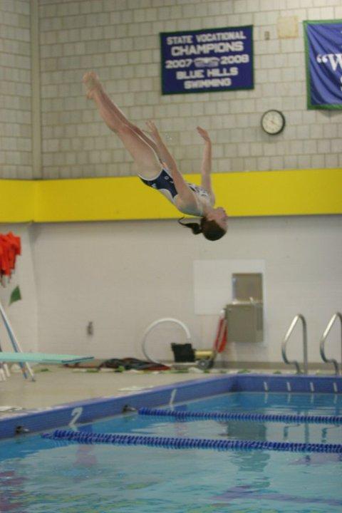 Junior Sydney Gillis dives during the Framingham meet.