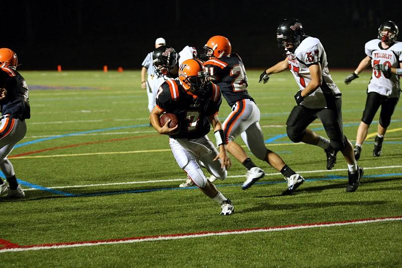Senior quarterback Troy Salvatore runs the ball.