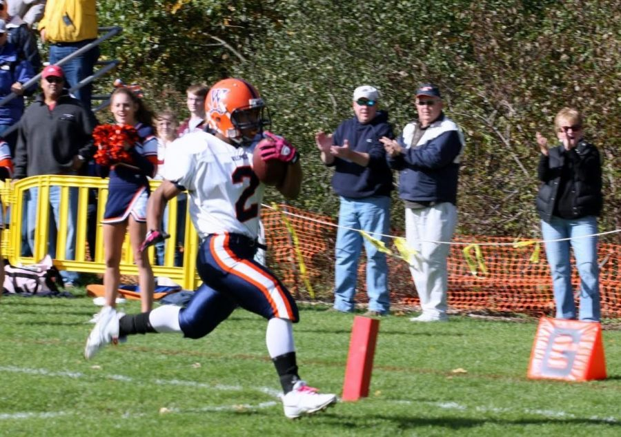 Senior runningback Kenny Woods rushes for a touchdown.