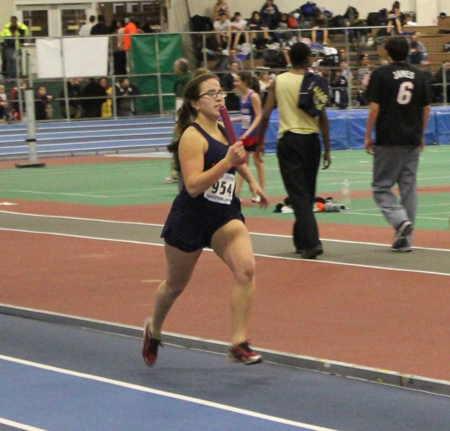 Senior Liz Jelloe competes in the relay.