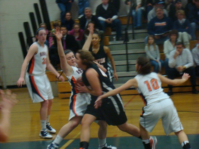 Sophomore Lauren Bodin takes a charge against Newton North.