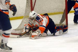 Sophomore goalie Ray Mortali makes a save in the Rebels 3-2 shootout loss in the Milbury Cup Championship. (Photo/ Keith Lewis)