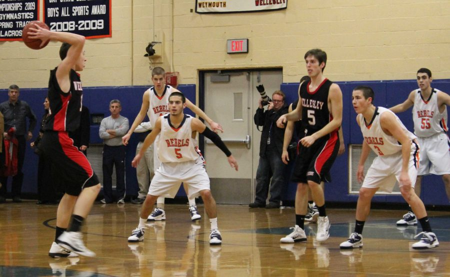 The Rebels played tough defense in the second half to surge past the Raiders.