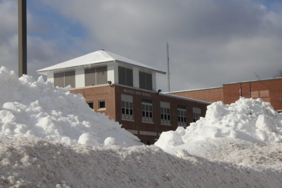 Historic snow fall amounts have left Walpole High School's parking lot full of colossal snowbanks.
