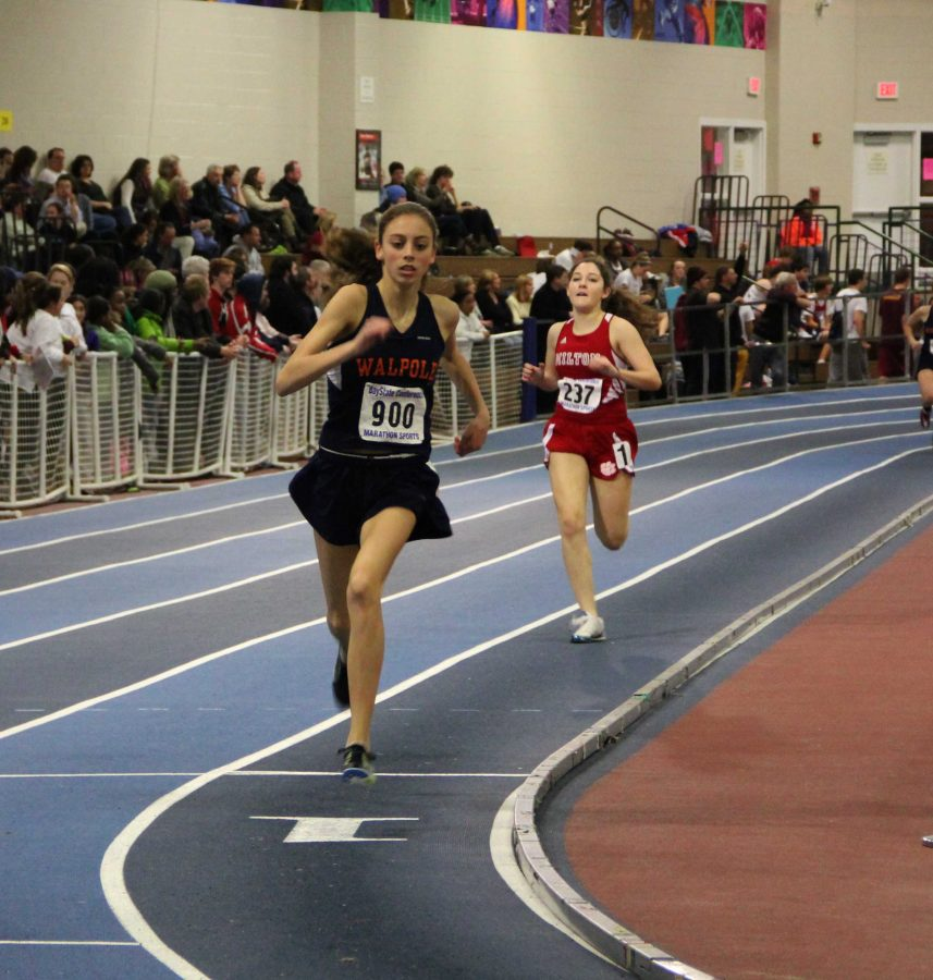 Freshman Gina Conti finishes her second lap of the 600m, closely followed by a Milton runner.