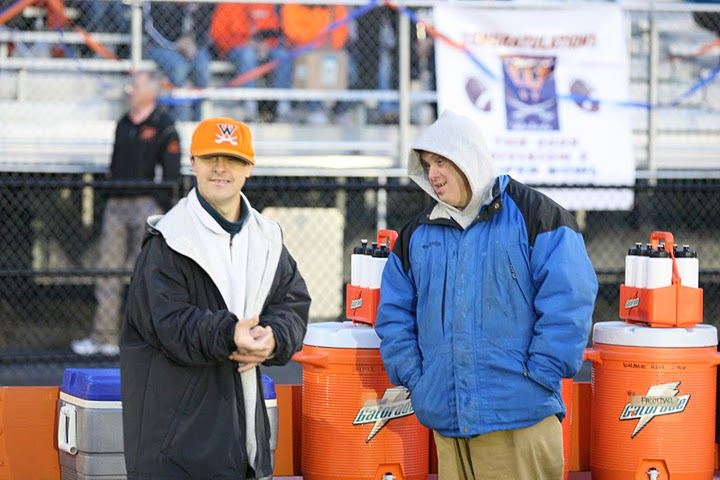 Managers, Bruce and Baldy, help fill the water during a home game. (Photo/Greg Salvatore)
