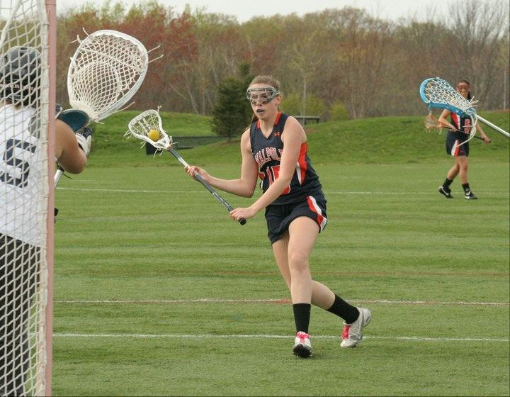 Freshman Ashley Waldron winds up for a shot against the Norwood goalie.