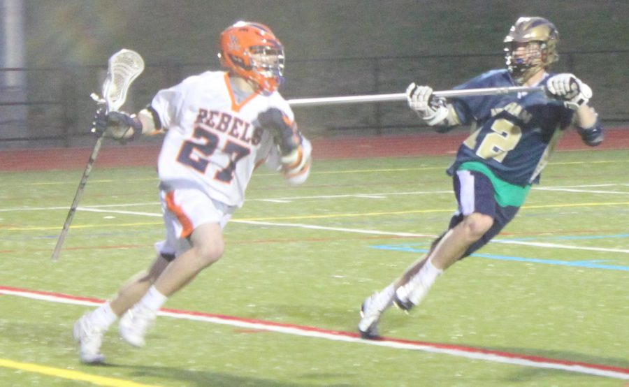 Riley, Rockets Prevail Over Rebels in Bay State Showdown