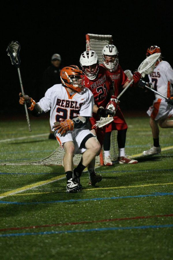 A Walpole attackman drives to the cage. (Photo/Kim Guilbert)