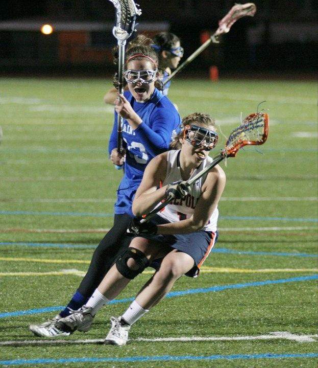 Senior Captain Sarah Buckley protects her stick to avoid a check from the opposing team.