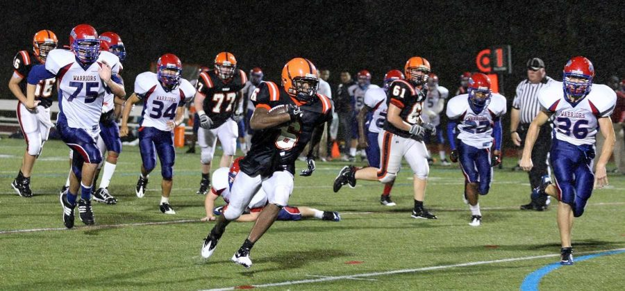 A Walpole running back looks for the end zone. (Photo/Greg Salvatore)