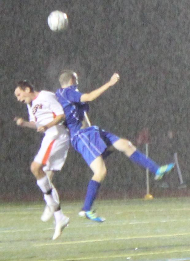A Walpole defender battles with a Braintree player for the ball. (Photo/Russell Ollis)
