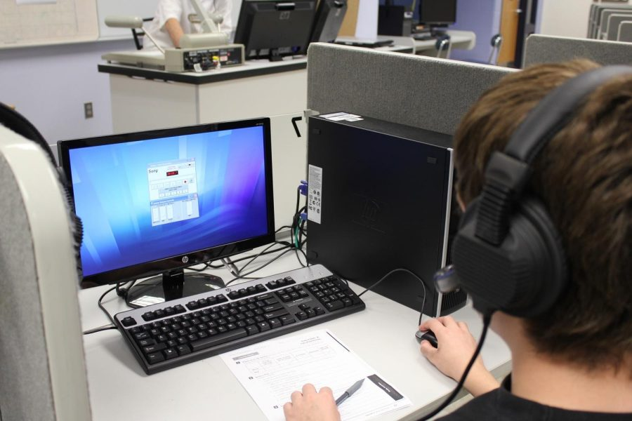 Student uses the new technology in the language lab. (Photo/Derek Caneja)