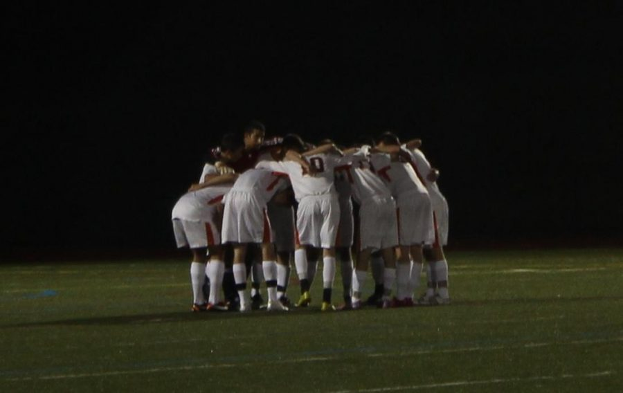 Rebels prepare for their battle with Natick. (Photo/Russell Ollis)