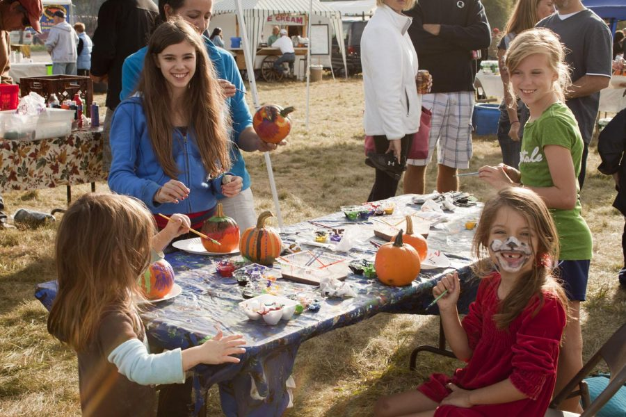 Kids take advantage of the pumpkin painting table at Lions Club Field Day.