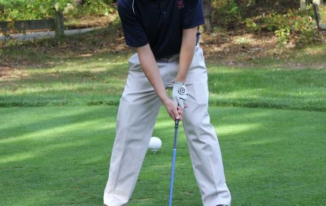 Walpole Golfer lines up for a drive.