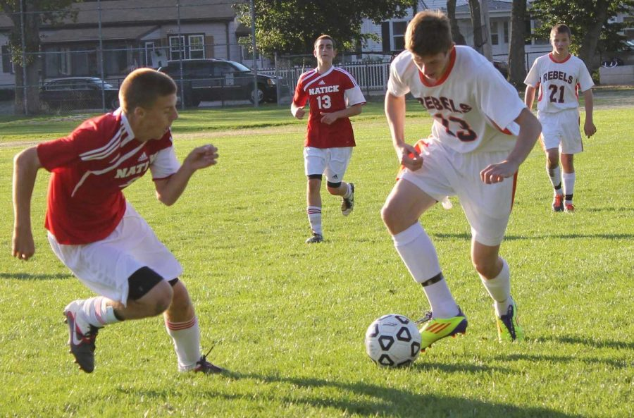 A Rebel midfielder carries the ball upfield. (Photo/ Jake Moser)
