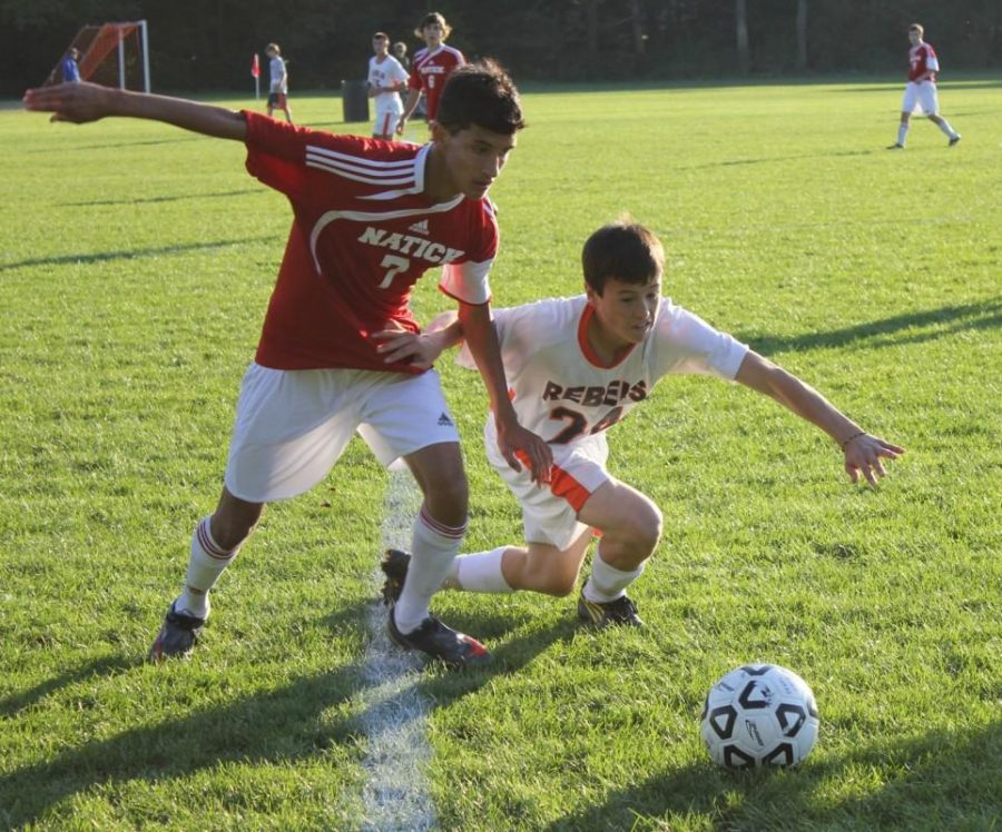 One of the Rebel players battles for the ball against Natick. (Photo/Jake Moser)