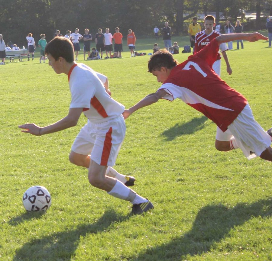 A Rebel midfielder blows by the opposing teams defender (Photo/ Jake Moser)