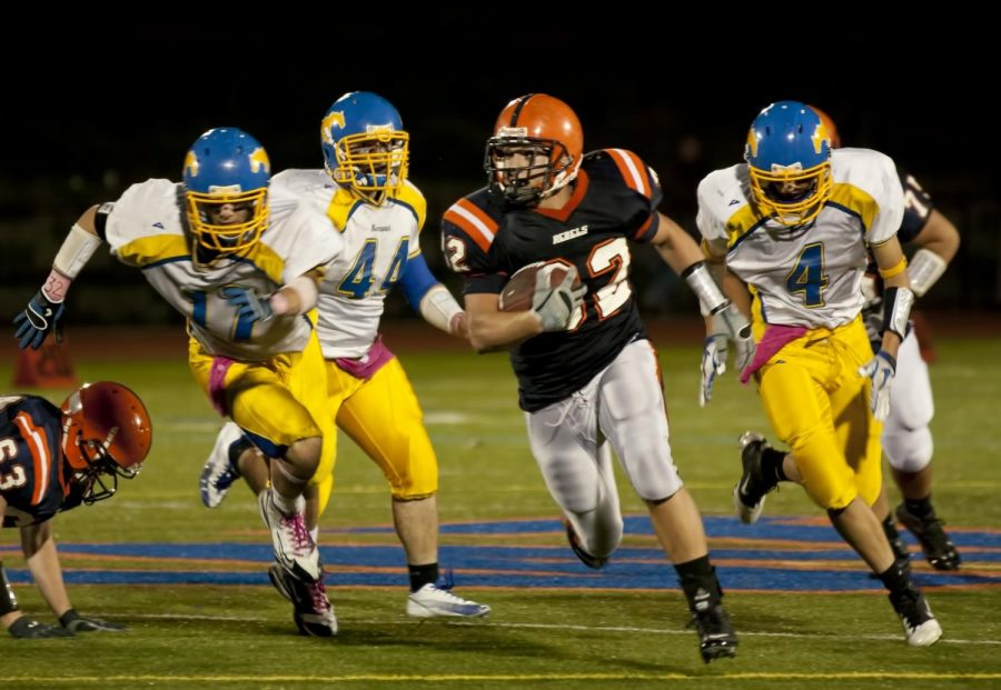 The Walpole running back evades Norwood defenders to get a first down. (Photo/Tim Hoffman)