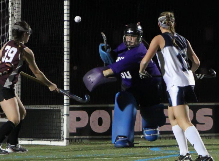 Walpole goalie blocks a shot on net.