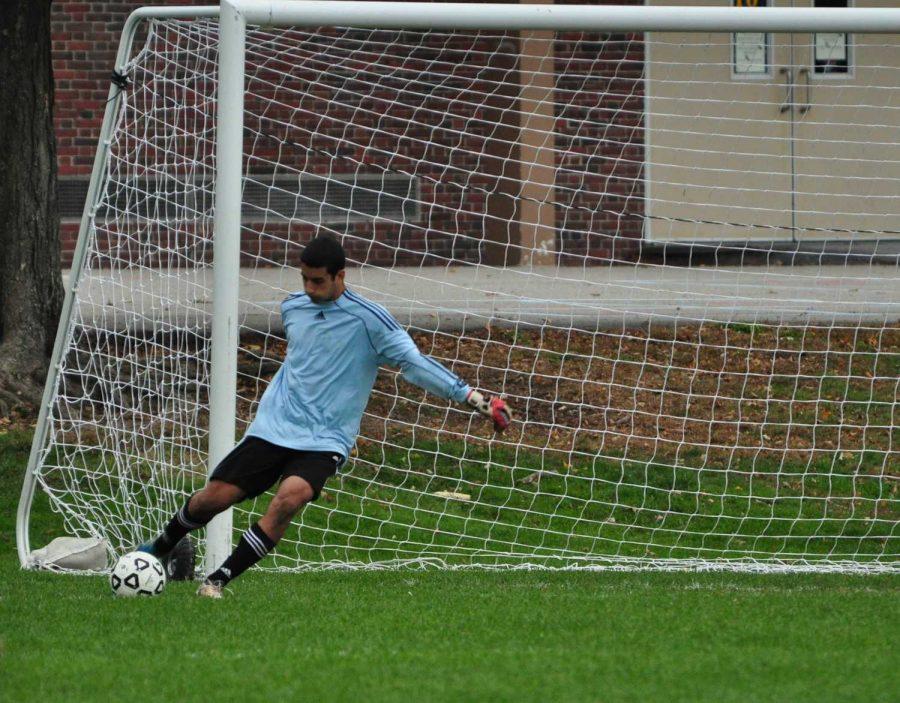 Walpole Rebels Goalkeeper kicks the ball downfield.