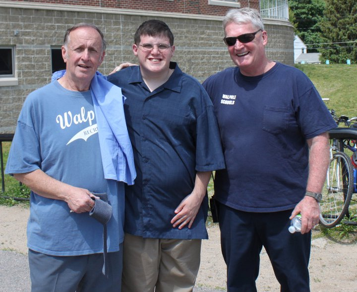 Rich McCarthy poses with a student, Peter Clow and head WHS janitor, Al Brown.