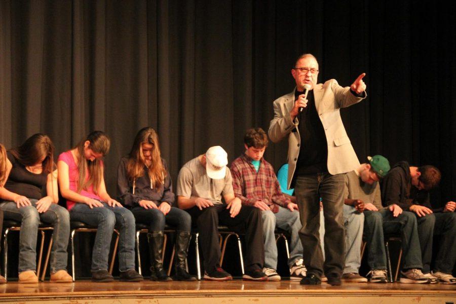 Jim Spinnato hypnotizes a group of senior volunteers.