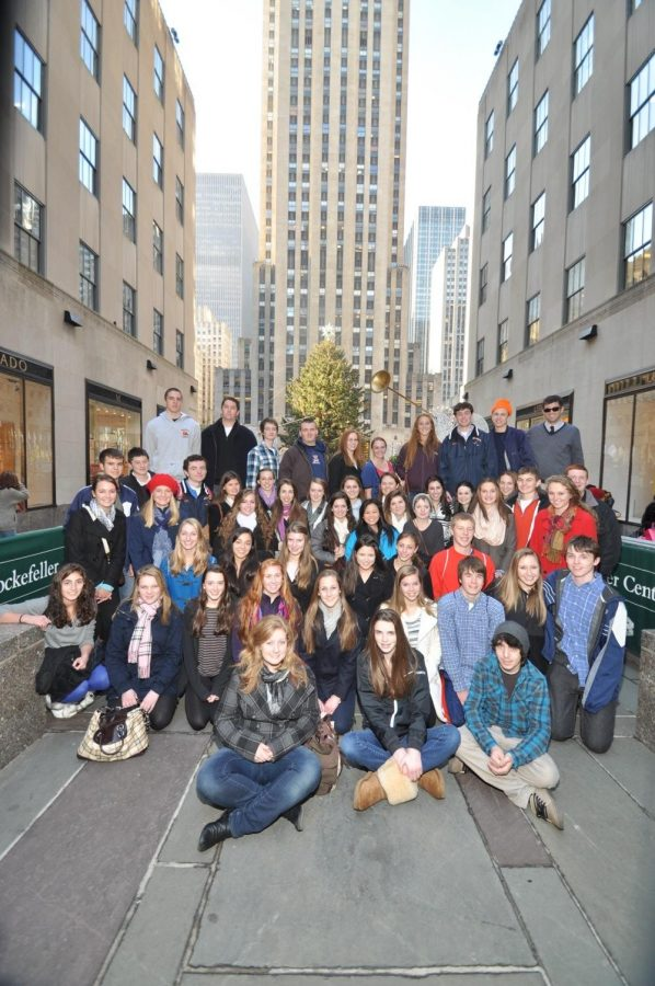 The Walpole High School Rebellion Staff poses for a picture in front of the Rockefeller Tree