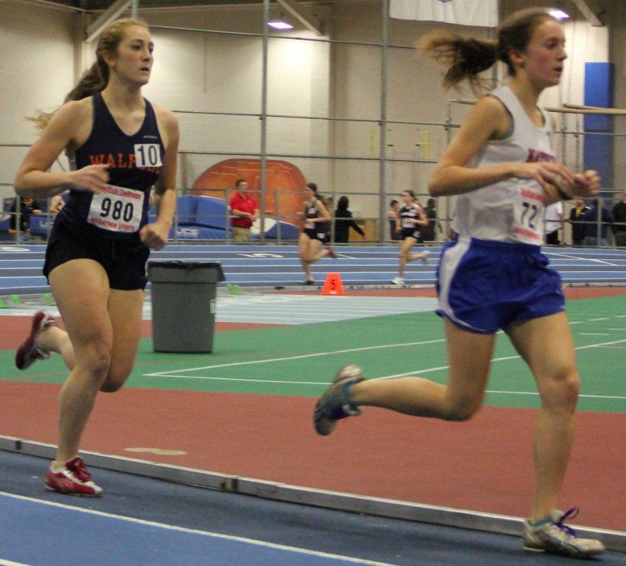 Walpole mile runner speeding up to pass a fellow competitor. (Photo/Derek Caneja)