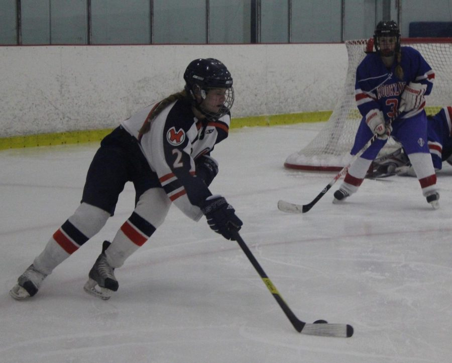 A Walpole athlete skates around Brookline, looking for an opportunity to score.