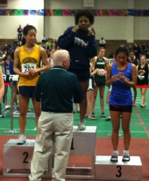 A Walpole athlete receives first place for long jump. (Photo/Conor Cashman)
