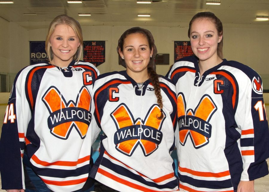 The captains of the Walpole Rebels Girls Hockey Team poses for a picture.
