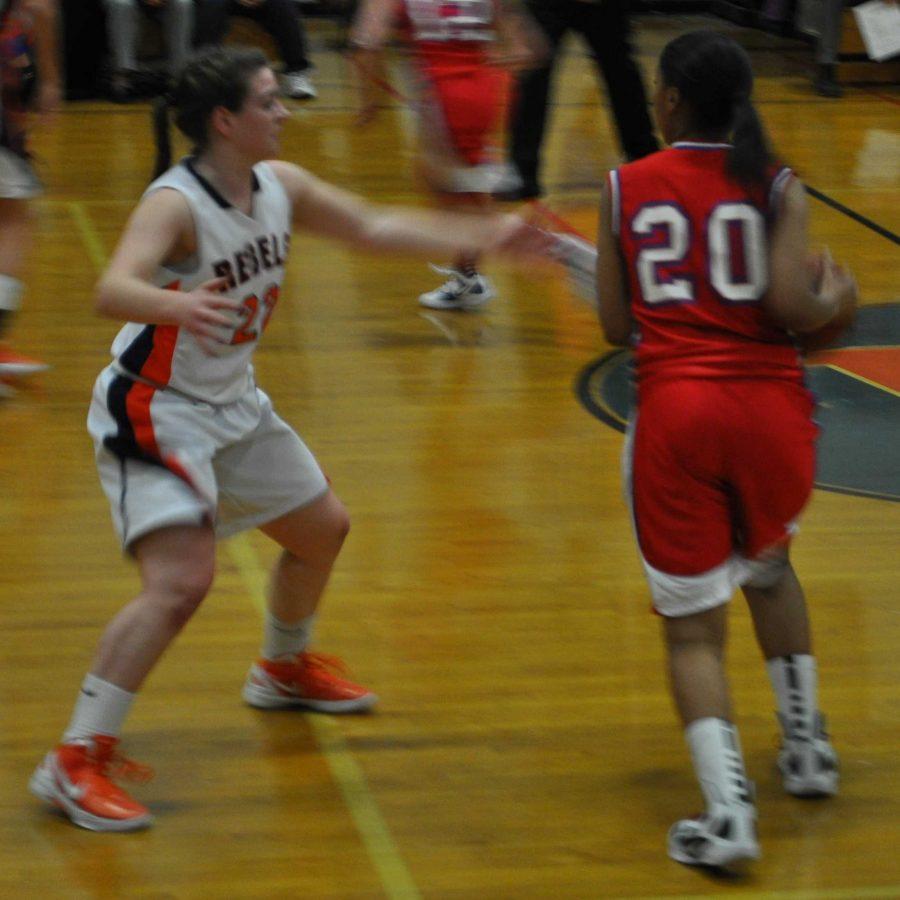 A Walpole guard defends a Brookline player.