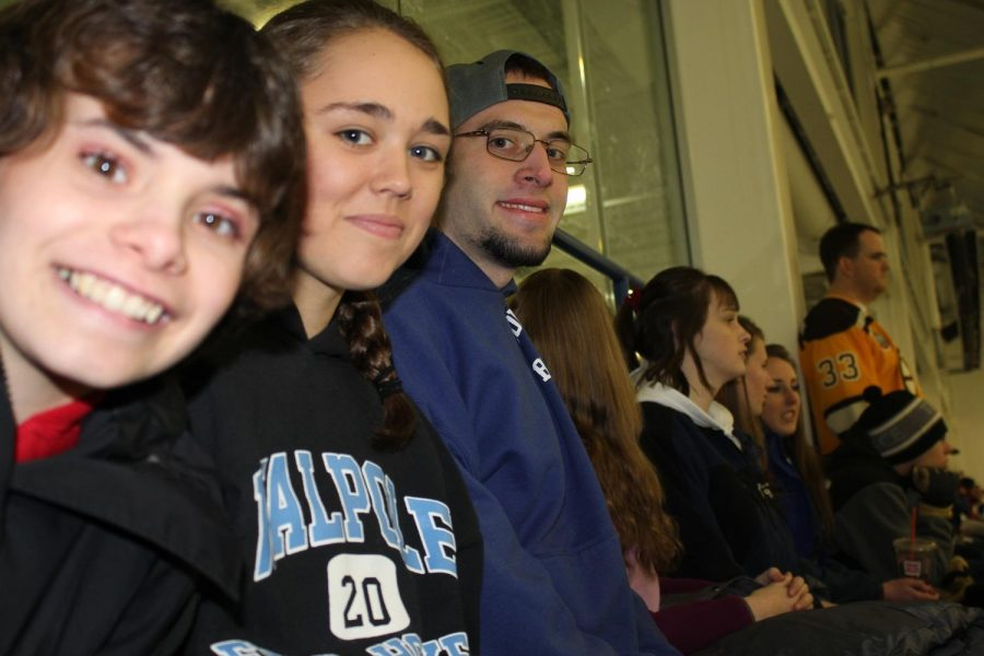 Best Buddies' members pose for a picture while watching a Rebels Hockey Game.