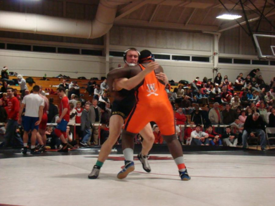 A Walpole wrestler prepares to throw his opponent.
