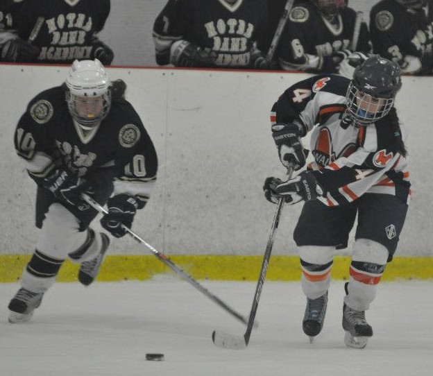 A freshman forward steals the puck away from a Notre Dame Academy player. (Photo courtesy of Mrs. Barry)