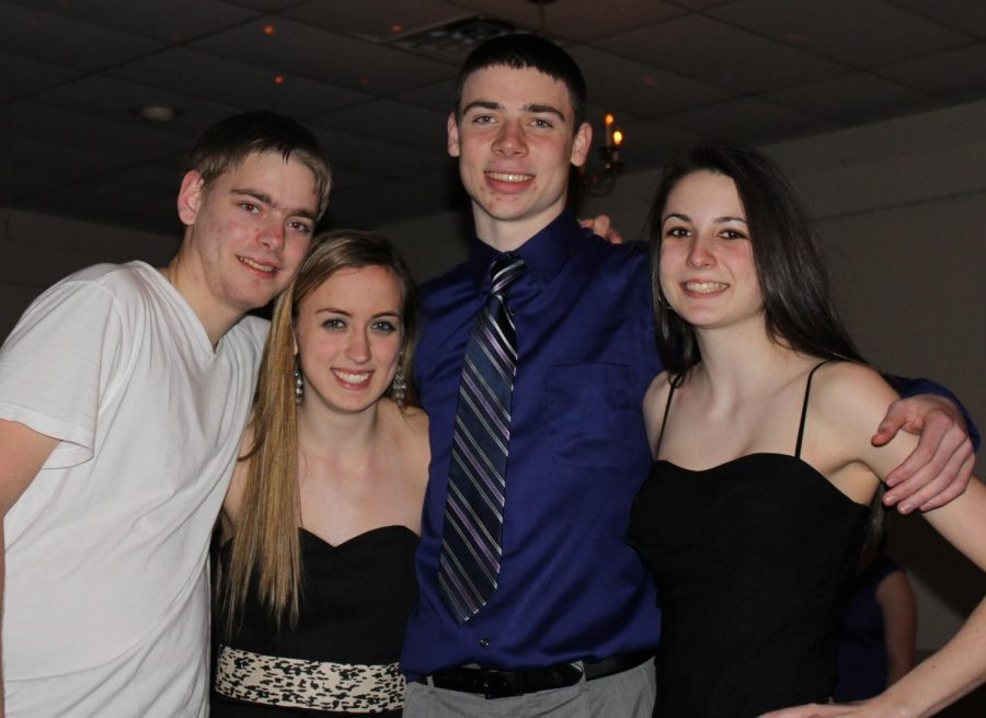 Students pose for a picture at the dance.