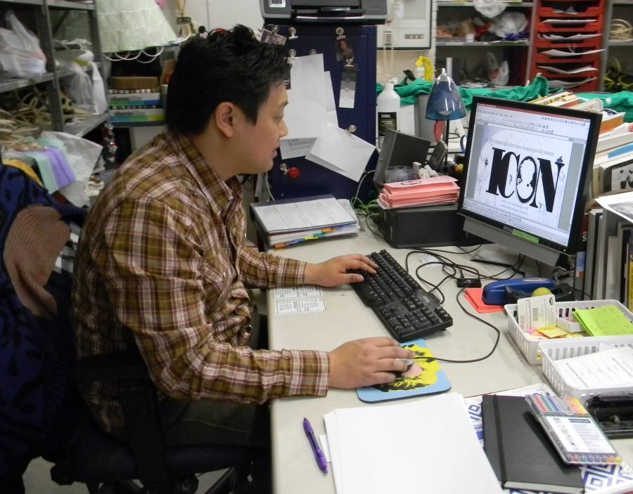 Mr. Kim edits a poster for the Dance Company show.