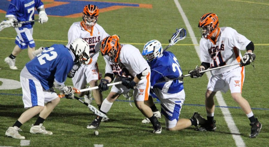 Walpole and Braintree players competing for possession of the ball. (Photo/Jake Moser)