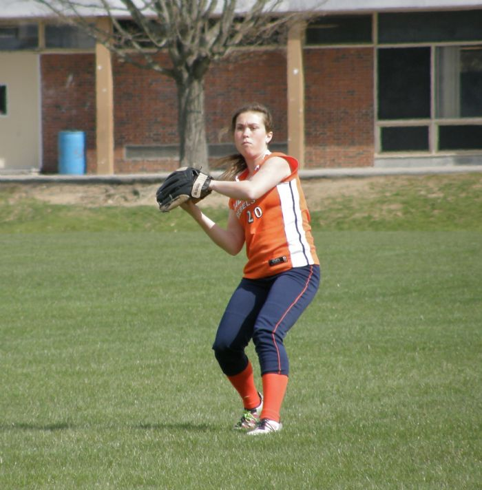 Walpole's left fielder throws a ball to second base to make a play.