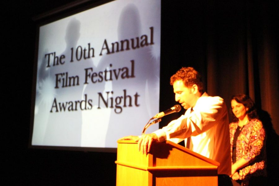 Mr. Alan welcomes the audience to the 10th Annual Film Festival Awards Night
