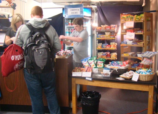 A student purchases treats from the Rebel Closet