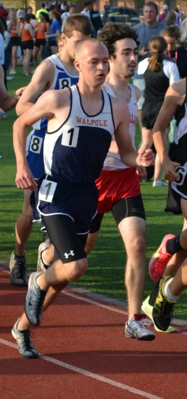 A Walpole runner competes in the mile at the BSC meet.