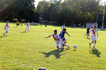 A Walpole Player Slides in for a Ball