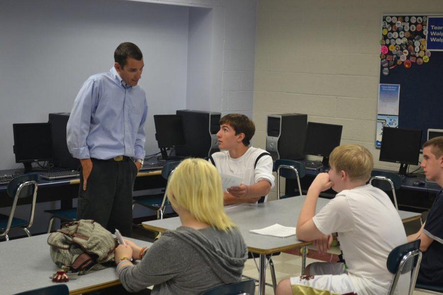 An incoming freshman asks questions to Walpole High teacher Mr. Hinck