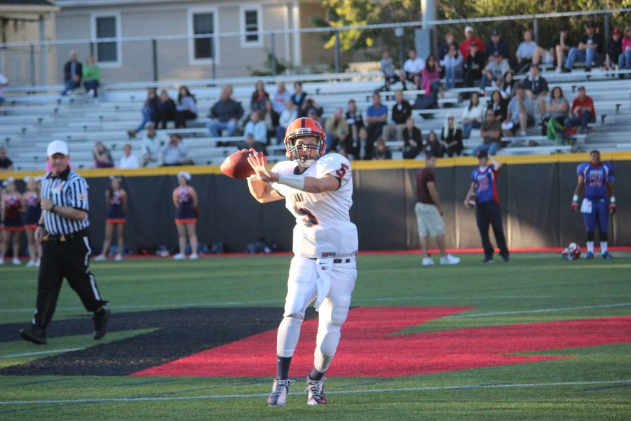 A Walpole player throws the ball.