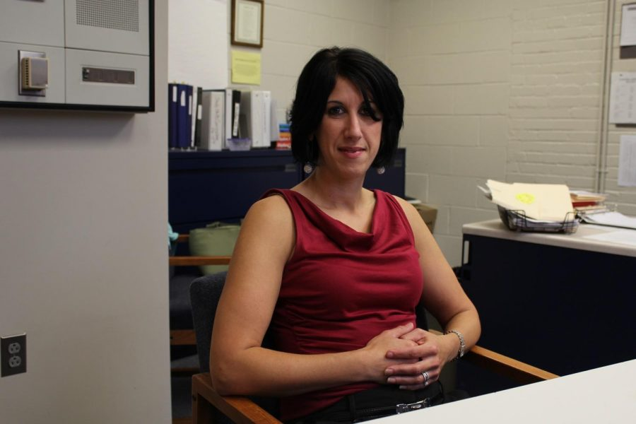 Macrina poses for a photo in her office.