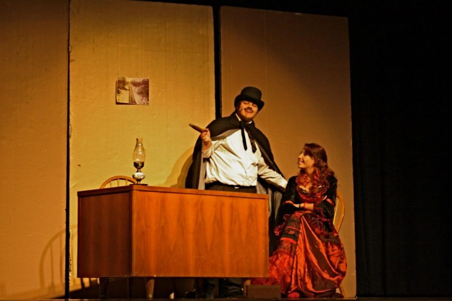 Villain Simon Darkway schemes with cohort Carlotta Cortez during the show.