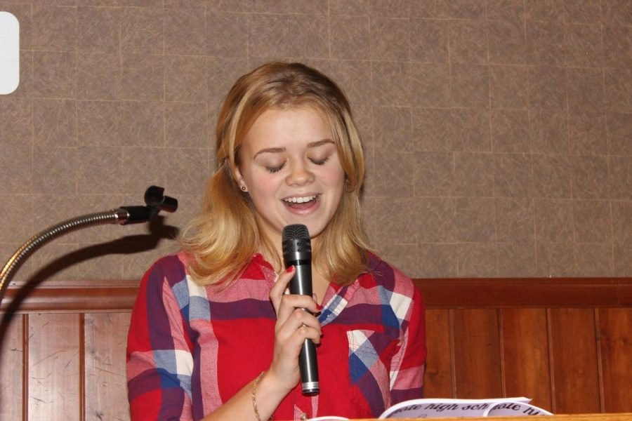 A Walpole High Student reads her original writing during the Poetry Reading.